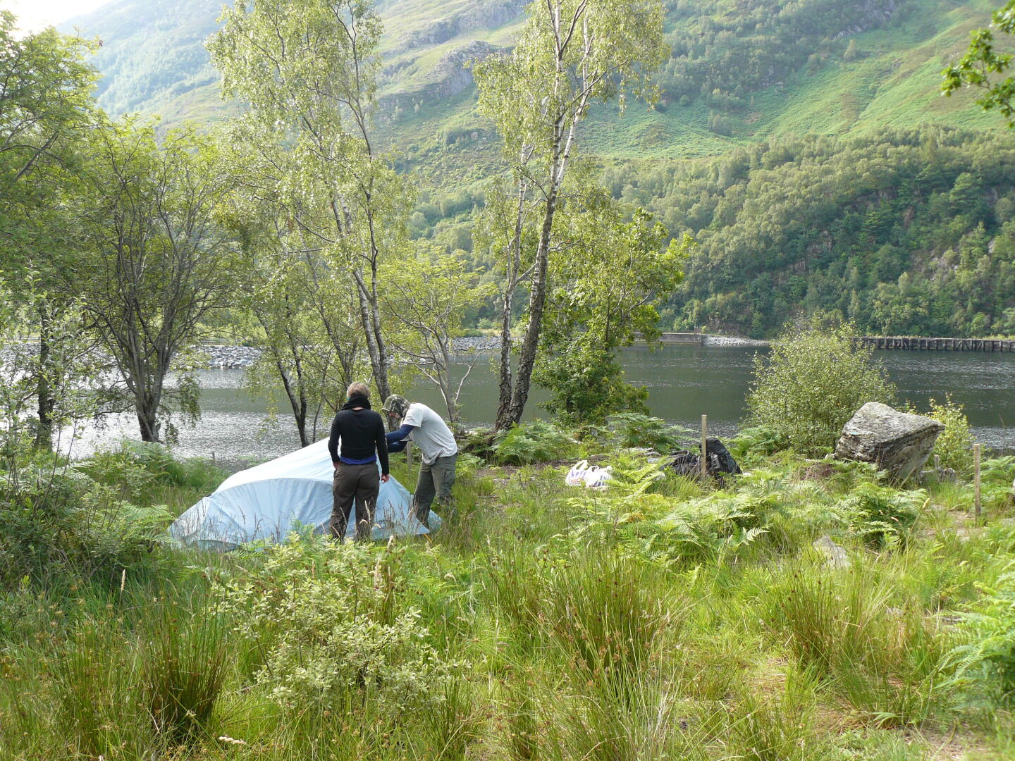 Campsite near Kinlochleven. The fire is supposed to keep the midges away, but I guess they do not know about this. Right photo (c) James Mellors