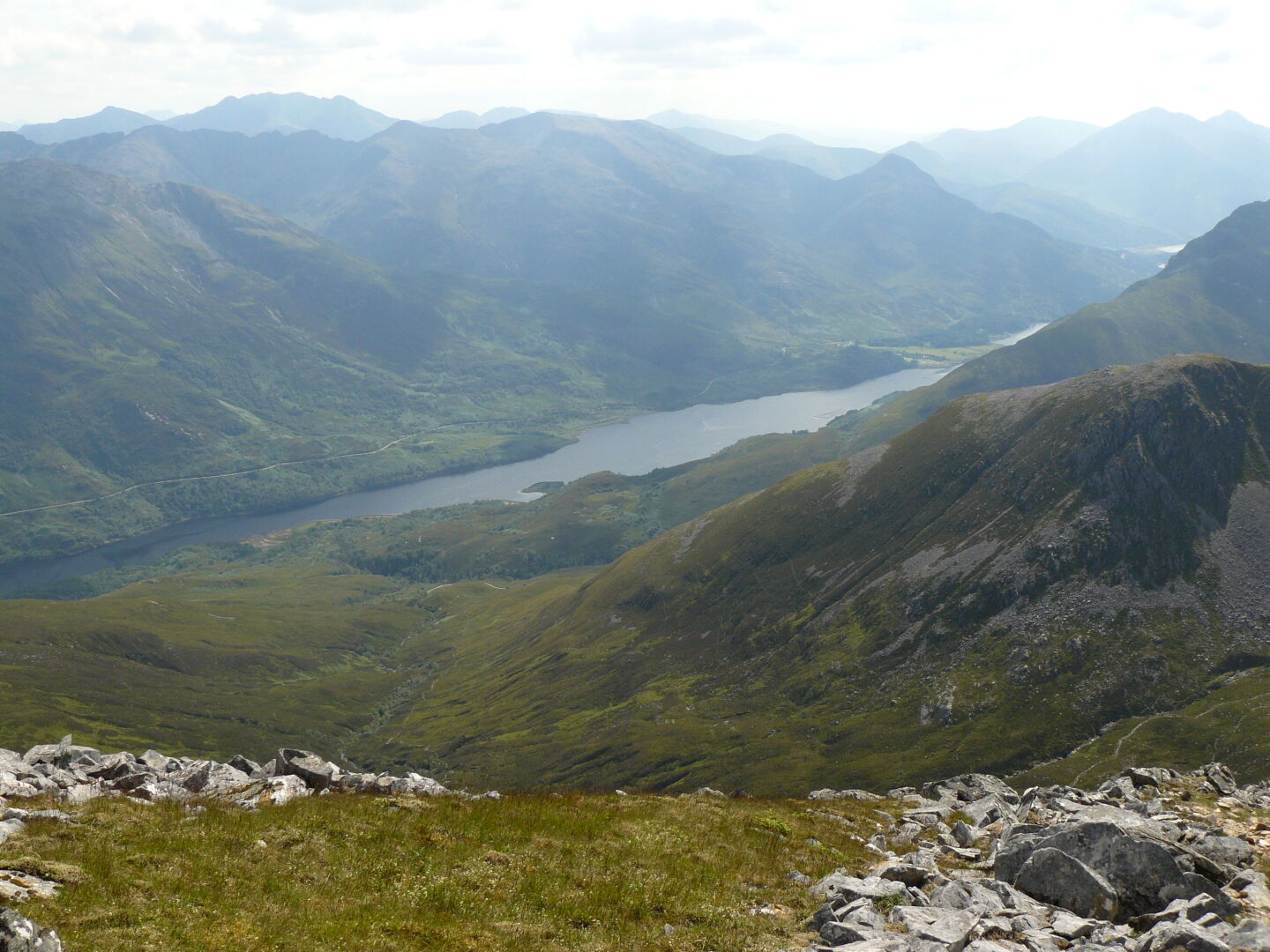 Loch Leven lies far below us to the south, and Ben Nevis in the North. Meandering streams decorate the valleys in between. Right image (c) James Mellors.