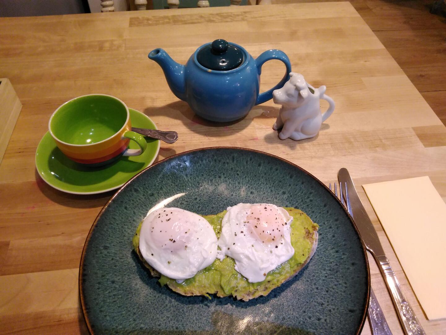 Lunch at Mad Hatter's, Chester: avocado spread, poached eggs, and Earl Grey tea with milk fresh from the cow.